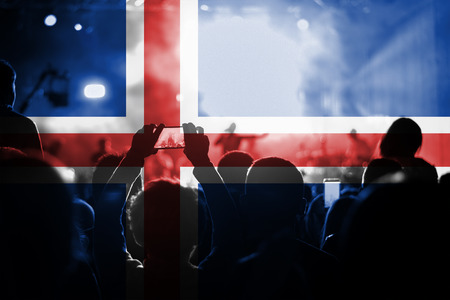 iceland flag: live music concert with blending Iceland flag on fans Stock Photo