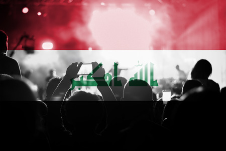 iraq flag: live music concert with blending Iraq flag on fans Stock Photo