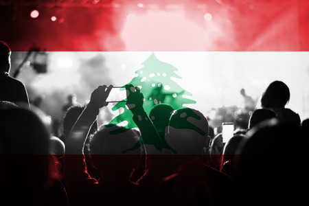 blending: live music concert with blending Lebanon flag on fans