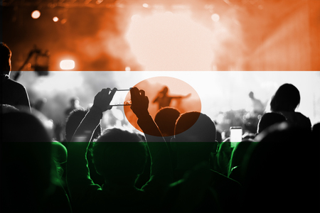live music concert with blending Niger flag on fans Stock Photo