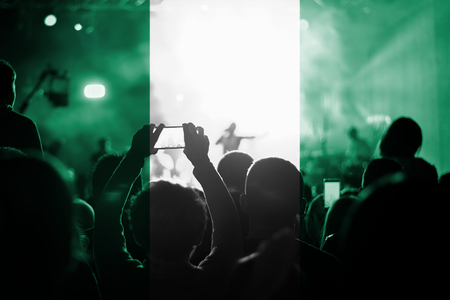 live music concert with blending Nigeria flag on fans Stock Photo