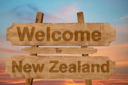 new zeland: Welcome to New Zeland sign on wood background