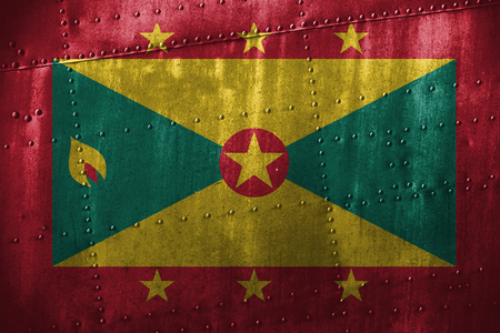 metal texutre or background with Grenada flag