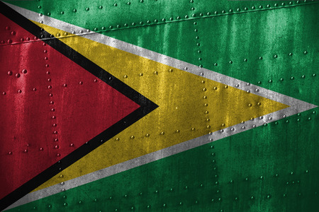metal texutre or background with Guyana flag