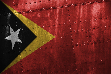 metal texutre or background with Timor-Leste flag