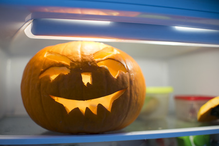 fridge: halloween pumpkin in the fridge Stock Photo