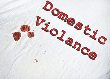 Domestic Violance sign on white sheet with blood