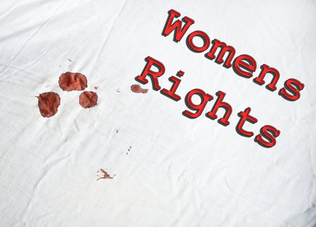 Womans Rights sign on white sheet with blood