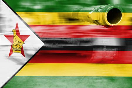 military strength theme, motion blur tank with Zimbabwe flag Stock Photo