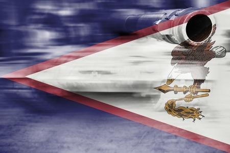 military strength theme, motion blur tank with American Samoa flag Stock Photo