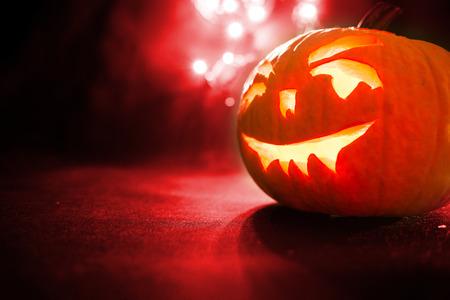 Halloween pumpkin with red  bokeh background