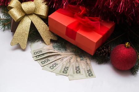 finanse: Christmas Gift box  with Polish PLN money on white background