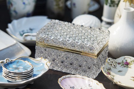 luxory chest and porelain plates on table
