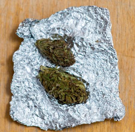 close up on Marijuana in tin foil on table