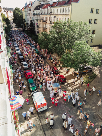 wroclaw: Wroclaw, POLAND - June 15, 2017: Religious procession at Corpus Christi Day in one of the suburban districts of Wroclaw. June 15, 2017. Wroclaw, Poland.