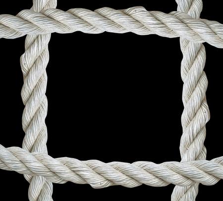 cordage: Close up on white rope frame isolated on  black background Stock Photo