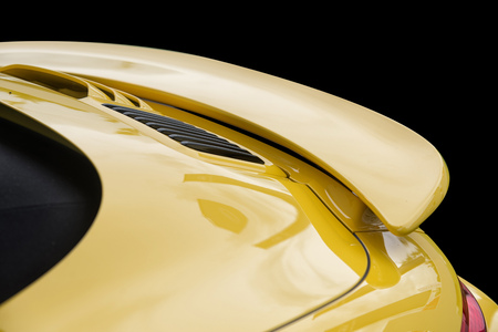 Close up on yellow sport car rear spoiler