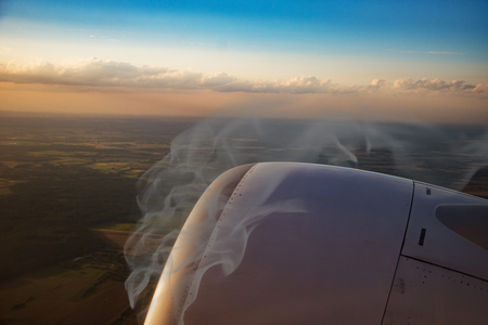 burning plane engine, fire and smoke, view from the window Stock Photo