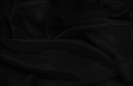 close up on dark  silk material background or texture Stock Photo