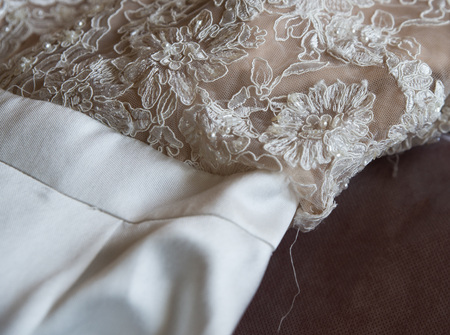 close up on ripped wedding dress