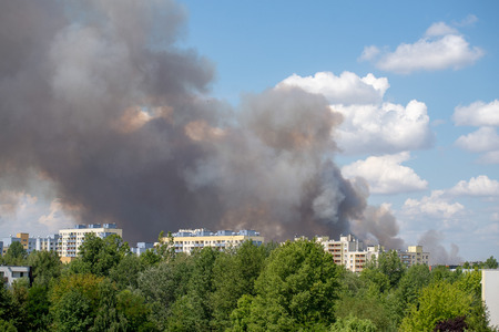 smoke over the city, fire in the metropolis Stock Photo