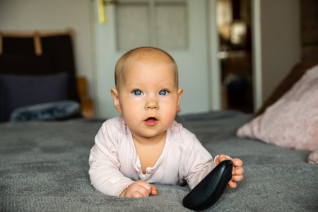 small child, first steps on the internet, a newborn baby is holding a mouse from the computer