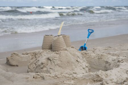 close up on sand castle on the beach