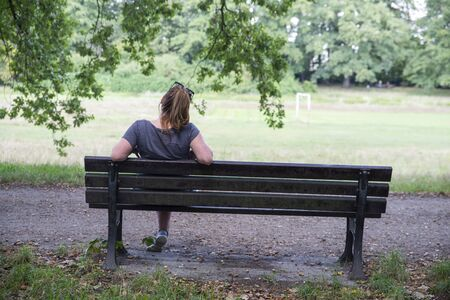 close up on lonely woman on the bench Stok Fotoğraf