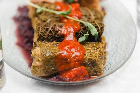 vegan gluten-free stuffed cabbage with millet and forest mushrooms, red onion jam