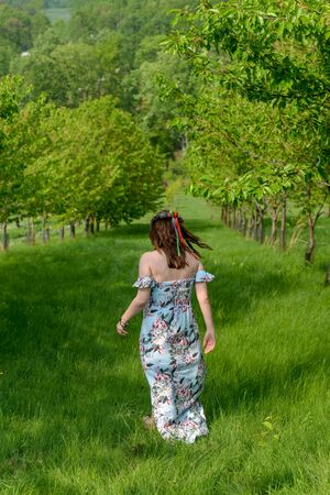 Slavic woman in a fruit garden