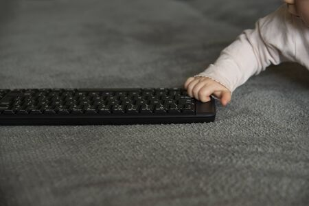 baby hand taking a keyboard, motion blur, addiction to technology at a young age Stok Fotoğraf