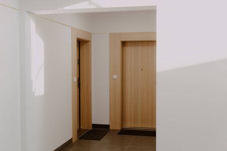 corridor in the building with door to the flat