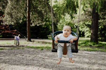 small child is having fun on a swing Stok Fotoğraf