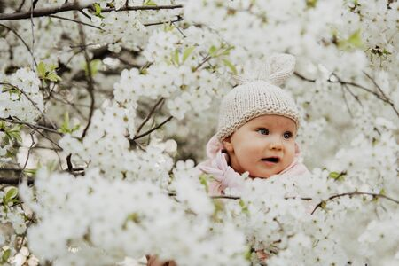 a little girl dressed up as a bunny in flowers, Easter