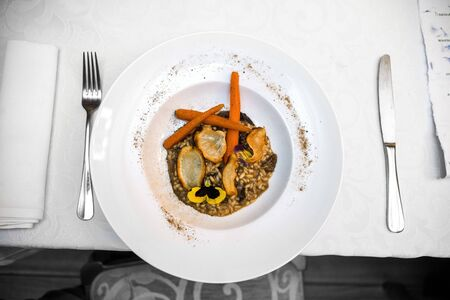 vegan gluten-free risotto with wild mushrooms, glazed carrots, parsley chips and forest powder