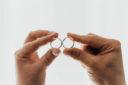 close up on wedding rings, and white background