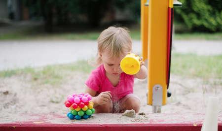 baby girl playing in the children playground Stock Photo