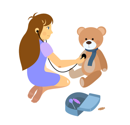 toy chest: little girl playing a doctor with plush teddy bear toy