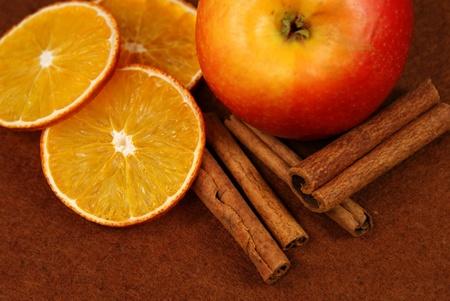 still life with apple, orange, cinnamon photo