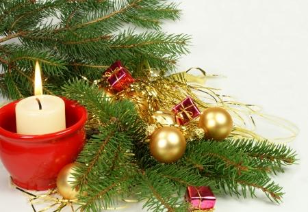 Candle with christmas ball photo