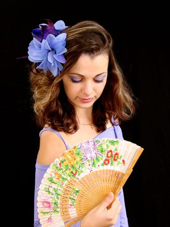 downwards: The girl with a fan looks downwards
