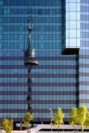 distortion: Reflexion of a television tower in the house of modern construction