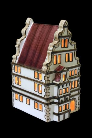 faience: Faience small house with a candle burning inside Stock Photo