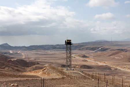 observant: Observant tower and the barbed wire dividing desert