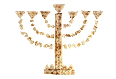 Menorah, composed of pieces of matzah on a white background photo