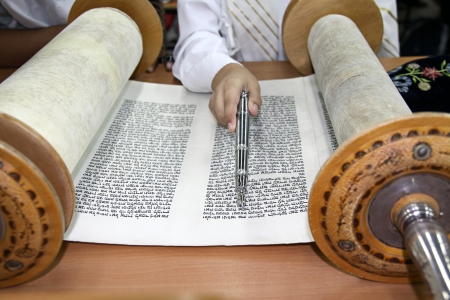 judaism: Reading a Torah scroll with the pointer for reading the Torah in the hand