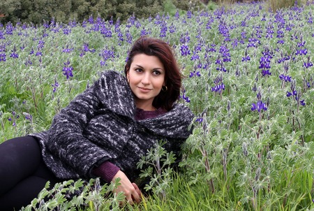 lupines: Young woman lying in a meadow of lupines