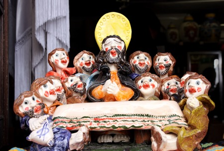 OBIDOS, PORTUGAL - MAY 29, 2012: Clay Figurine Jesus Christ and the twelve apostles in a shop window