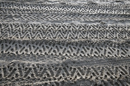 tread pattern: Traces of the car tread in the sand Stock Photo