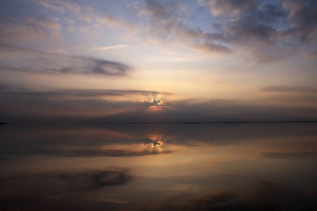 rising dead: Reflection of the sky and the rising sun in the Dead Sea